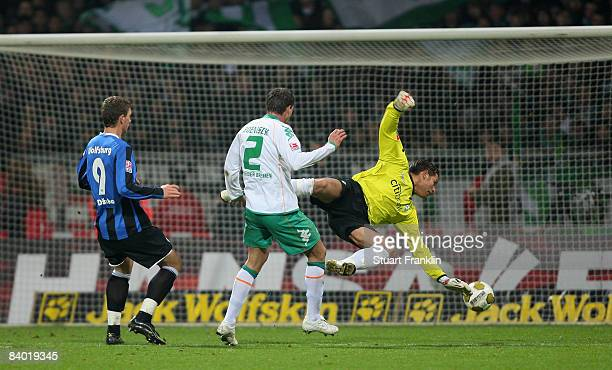 Goalkeeper Tim Wiese of Bremen makes a save from a shot from Edin Dzeko of Wolfsburg during the Bundesliga match between Werder Bremen and VfL...