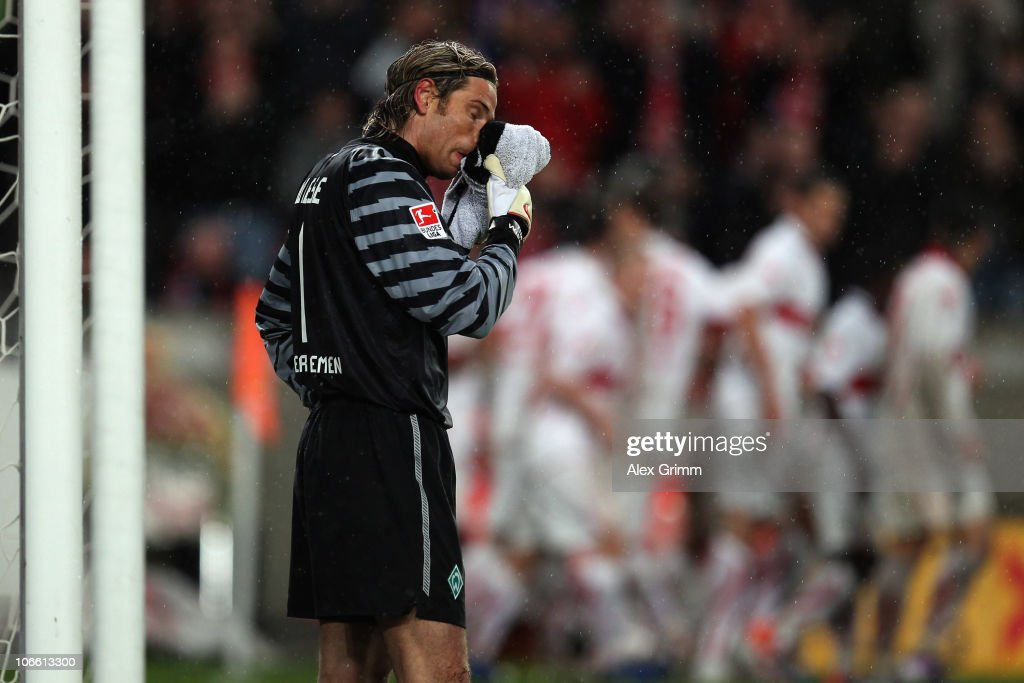 Goalkeeper <a gi-track='captionPersonalityLinkClicked' href=/galleries/search?phrase=Tim+Wiese&family=editorial&specificpeople=635015 ng-click='$event.stopPropagation()'>Tim Wiese</a> of Bremen reacts as Cacau of Stuttgart celebrates his team's third goal with team mates during the Bundesliga match between VfB Stuttgart and SV Werder Bremen at the Mercedes-Benz Arena on November 7, 2010 in Stuttgart, Germany.