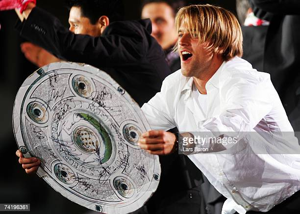 Goalkeeper Timo Hildebrand celebrates with the fans during the VfB Stuttgart champion's party at Schloss square on May 19 2007 in Stuttgart Germany...