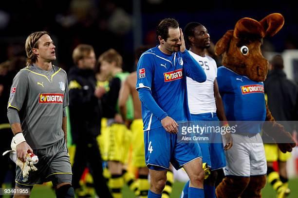 Goalkeeper Timo Hildebrand Josip Simunic Isaac Vorsah and mascot 'Hoffi' of Hoffenheim look dejected after the Bundesliga match between 1899...