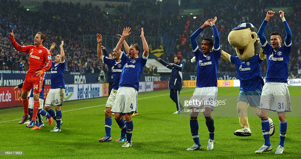 Goalkeeper Timo Hildebrand of Schalke celebrate with team mates after winning the Bundesliga match between FC Schalke 04 and Borussia Dortmund at Veltins-Arena on March 9, 2013 in Gelsenkirchen, Germany.