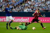Goalkeeper Timo Hildebrand of Schalke challenges Stephen El Shaarawy of Milan during the friendly match between Schalke 04 and AC Milan at...