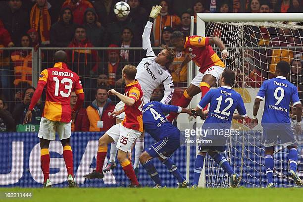 Goalkeeper Timo Hildebrand of Schalke is challenged by Didier Drogba of Galatasaray during the UEFA Champions League Round of 16 first leg match...