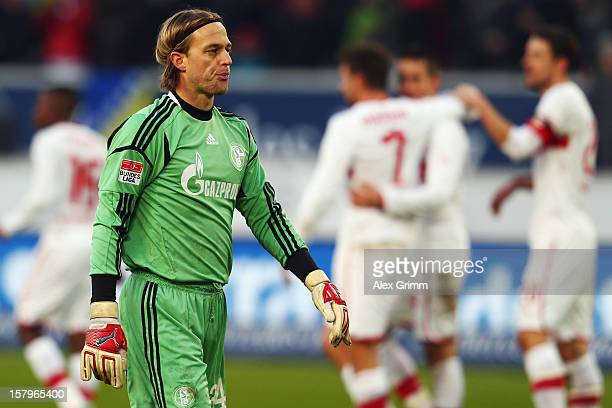 Goalkeeper Timo Hildebrand of Schalke reacts as Vedad Ibisevic of Stuttgart celebrates his team's second goal with team mates during the Bundesliga...