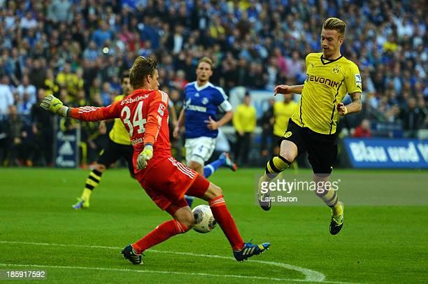 Goalkeeper Timo Hildebrand of Schalke saves a shoot of Marco Reus of Dortmund during the Bundesliga match between FC Schalke 04 and Borussia Dortmund...