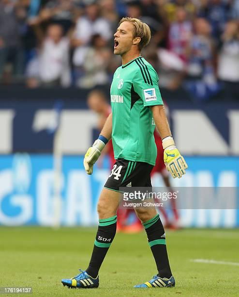 Goalkeeper Timo Hildebrand of Schalke shouts during the Bundesliga match between Schalke 04 and Hamburger SV at VeltinsArena on August 11 2013 in...
