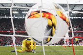 Goalkeeper Timo Horn of koeln attempts and fails to make the save from the shot and goal from Robert Lewandowski of Bayern Muenchen during the...