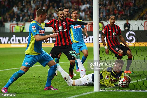Goalkeeper Timo Horn of Koeln catches the ball behind the goal line for Frankfurt's third goal during the Bundesliga match between Eintracht...