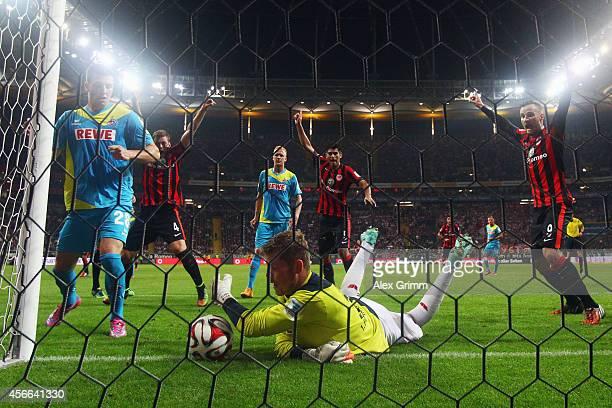 Goalkeeper Timo Horn of Koeln saves the ball behind the goal line for Frankfurt's third goal during the Bundesliga match between Eintracht Frankfurt...