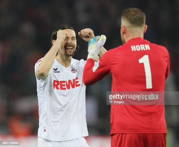 Goalkeeper Timo Horn of Koeln shakes hands with Neven Subotic during to the Bundesliga match between 1 FC Koeln and Werder Bremen at...