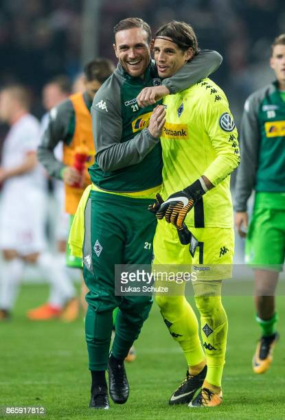 Goalkeeper Tobias Sippel and Goalkeeper Yann Sommer of Moenchengladbach celebrate after the DFB Cup match between Fortuna Duesseldorf and Borussia...