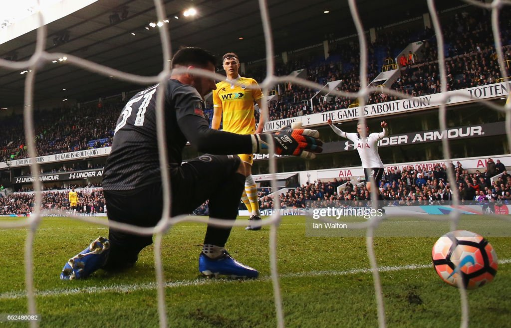 Goalkeeper Tom King of Millwall fumbles the ball as he fails to stop Heung-Min Son of Tottenham Hotspur scoring their sixth goal and completes his hat trick during The Emirates FA Cup Quarter-Final match between Tottenham Hotspur and Millwall at White Hart Lane on March 12, 2017 in London, England.