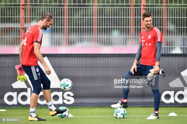Goalkeeper Tom Starke and Goalkeeper Sven Ulreich play with a ball during a training session at Saebener Strasse training ground on July 12 2017 in...