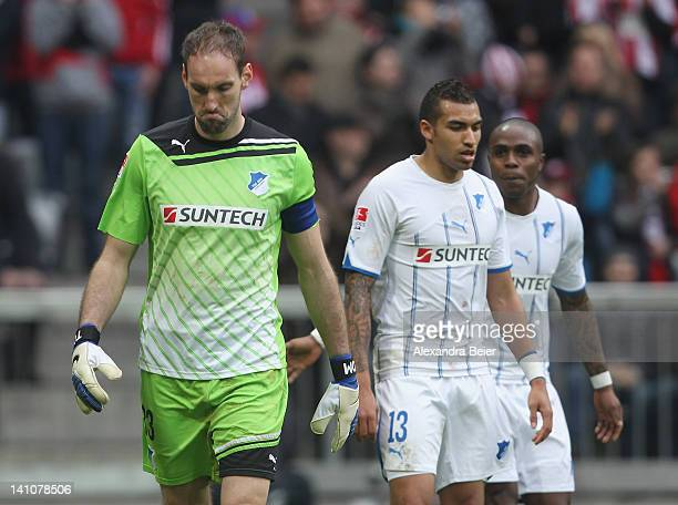 Goalkeeper Tom Starke and his teammates Daniel Williams and Edson Braafheid of Hoffenheim react after Bayern Muenchen scored their seventh goal...