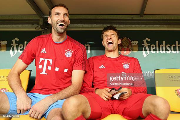 Goalkeeper Tom Starke and Thomas Mueller of Bayern Muenchen on the bench during the friendly match between SG Dynamo Dresden and FC Bayern Muenchen...