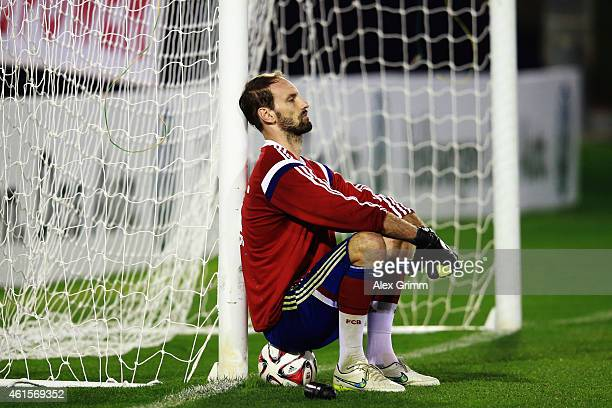 Goalkeeper Tom Starke sits on a ball during day 7 of the Bayern Muenchen training camp at ASPIRE Academy for Sports Excellence on January 15 2015 in...