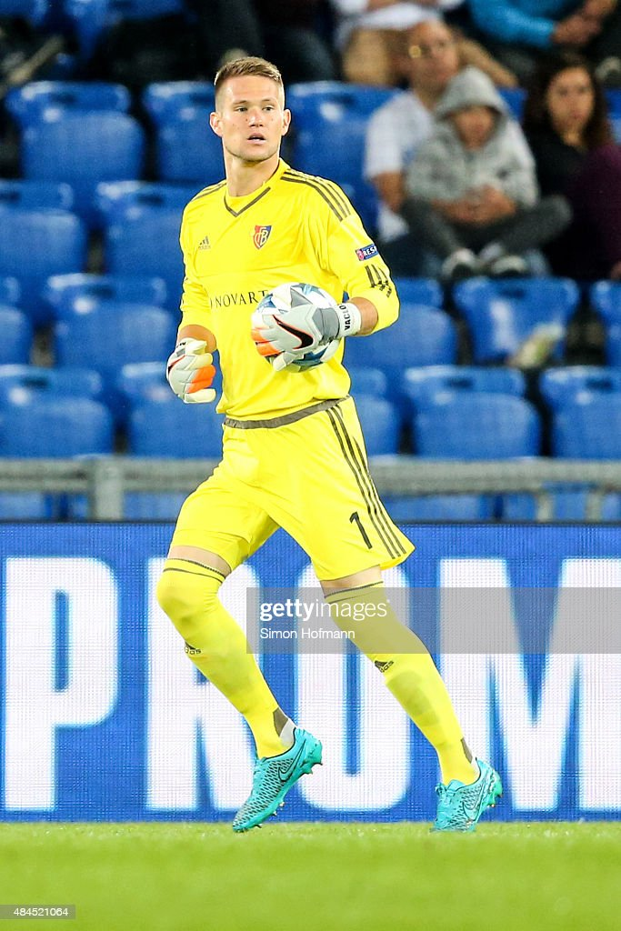 goalkeeper <a gi-track='captionPersonalityLinkClicked' href=/galleries/search?phrase=Tomas+Vaclik&family=editorial&specificpeople=5437912 ng-click='$event.stopPropagation()'>Tomas Vaclik</a> of Basel controls the ball during the UEFA Champions League qualifying round play off first leg match between FC Basel and Maccabi Tel Aviv at St. Jakob-Park on August 19, 2015 in Basel, Switzerland.
