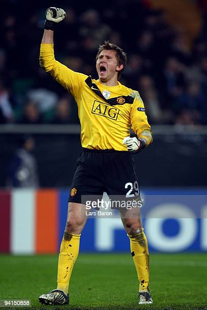 Goalkeeper Tomasz Kuszczak of Manchester celebrates after team mate Michael Owen scored the first goal during the UEFA Champions League Group B match...