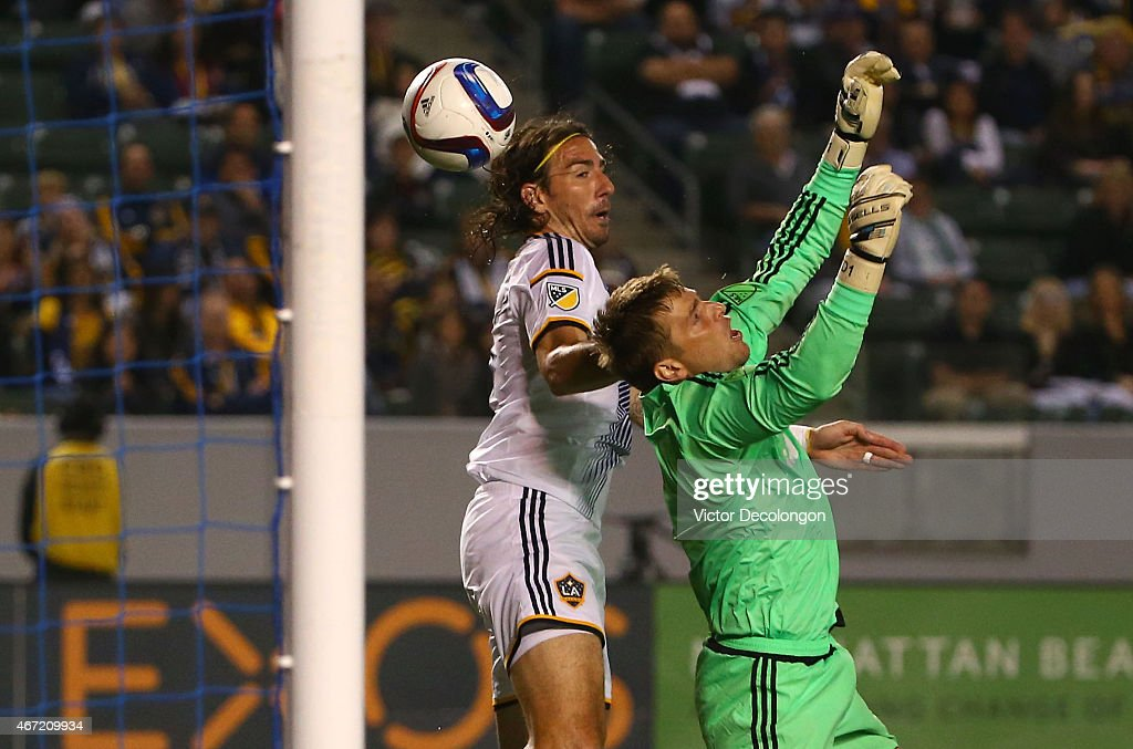 Goalkeeper Tyler Deric #1 of Houston Dynamo and <a gi-track='captionPersonalityLinkClicked' href=/galleries/search?phrase=Alan+Gordon+-+Soccer+Player&family=editorial&specificpeople=11667134 ng-click='$event.stopPropagation()'>Alan Gordon</a> #9 of Los Angeles Galaxy collide at the Dynamo goal line in the second half during the MLS match at StubHub Center on March 21, 2015 in Los Angeles, California. The Dynamo and Galaxy played to a 1-1 draw.