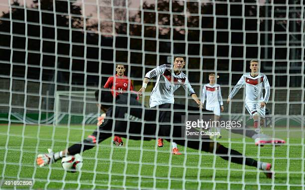 goalkeeper Ugurcan Cakir of Turkey with a penalty save against Maximilian Wittek of Germany during the U20 MercedesBenz Elite Cup match between...