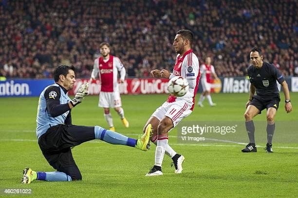 goalkeeper Urko Pardo of Apoel FC Lasse Schone of Ajax Ricardo Kishna of Ajax referee Carlos Velasco Carballo during the UEFA Champions League group...