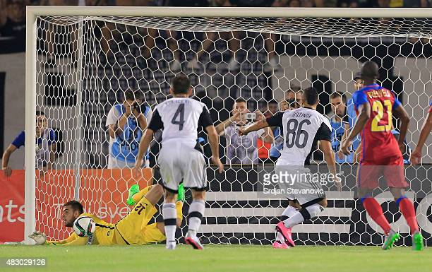 Goalkeeper Valentin Cojocaru of FC Steaua Bucharest saves a penalty kick taken by Valery Bozhinov of FC Partizan Belgrade during the UEFA Champions...