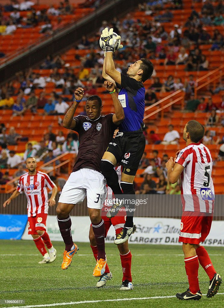 Goalkeeper Vedran Janjetovic #1 of the the Melbourne Heart FC leaps above Tyrone Marshall #34 of the Colorado Rapids to collect the ball during the Hawaiian Islands Invitational Soccer Tournament at the Aloha Stadium on February 25, 2012 in Honolulu, Hawaii. The Rapids defeated Heart FC 1-0 in the consolation game.