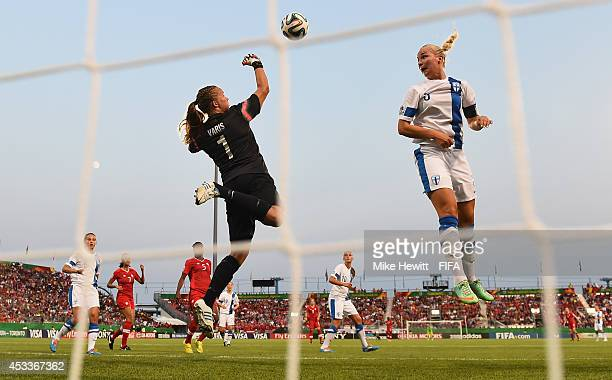 Goalkeeper Vera Varis of Finland punches clear as team mate Emilia Iskanius looks on during the FIFA U20 Women's World Cup Canada 2014 Group A match...
