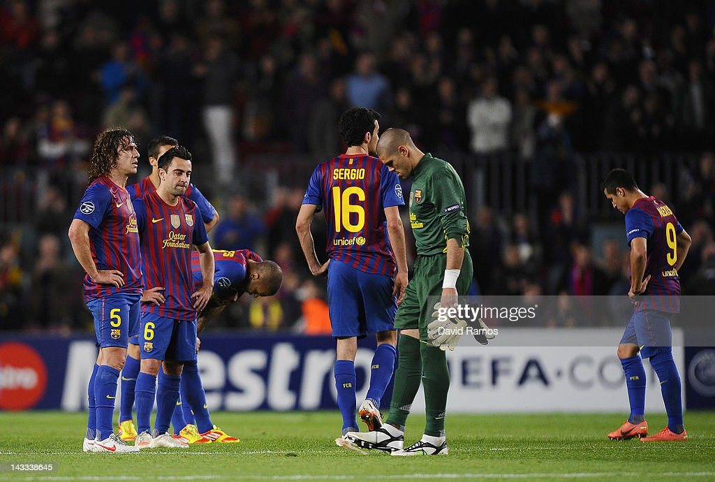 Goalkeeper Victor Valdés and FC Barcelona team-mates stand dejectedly at the end of the UEFA Champions League Semi Final, second leg match between FC Barcelona and Chelsea FC at Camp Nou on April 24, 2012 in Barcelona, Spain.