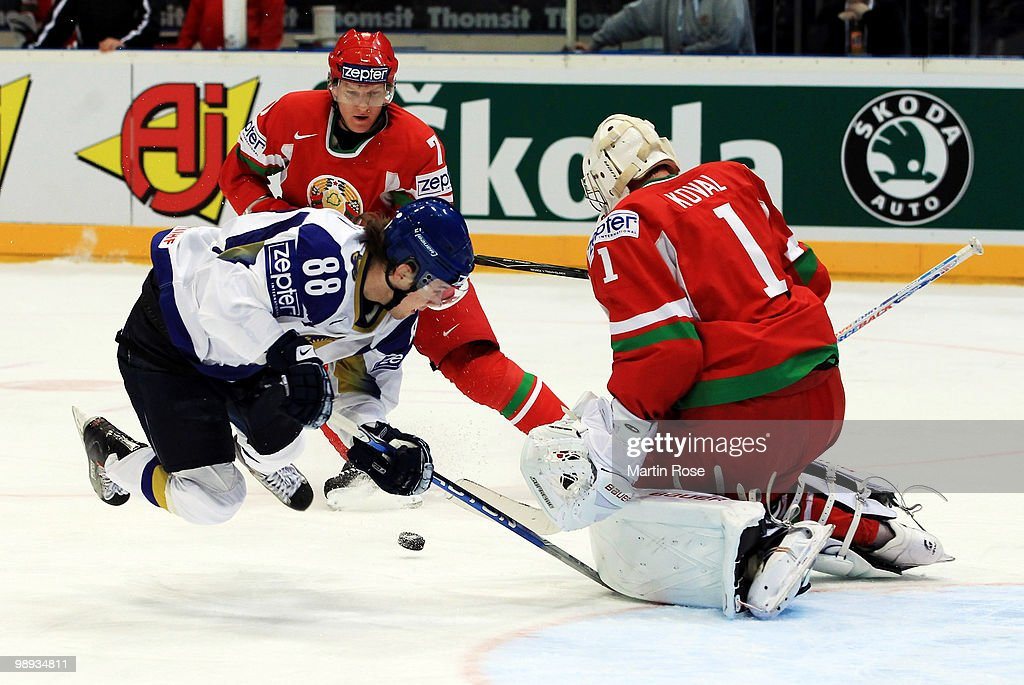 Goalkeeper Vitali Koval of Belarus saves the shot of Evgeni Rymarev of Kazakhstan during the IIHF World Championship group A match between Slovakia and Russia at Lanxess Arena on May 9, 2010 in Cologne, Germany.