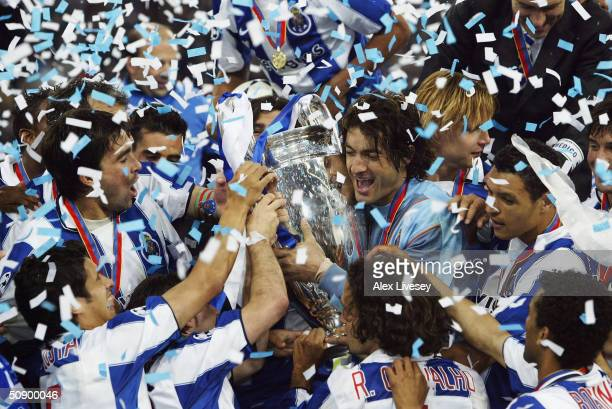 Goalkeeper Vitor Baia of FC Porto and his team mates celebrate winning the Champions League during the UEFA Champions League Final match between AS...