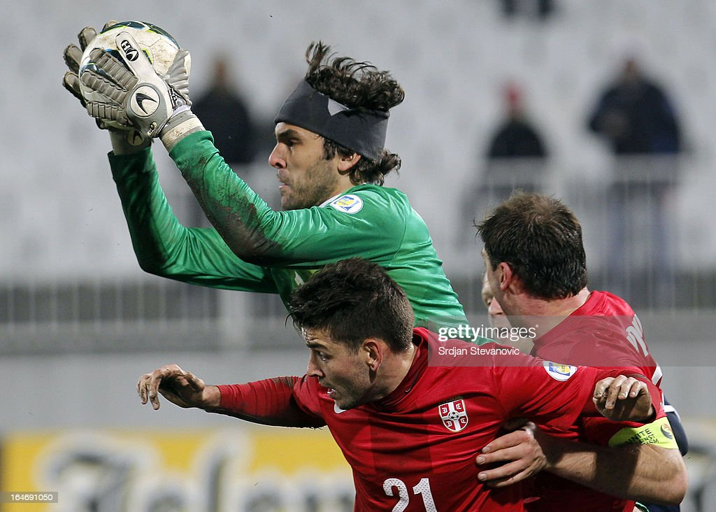 Goalkeeper Vladimir Stojkovic of Serbia (C) in action over the Filip Djordjevic (#21) of Serbia during the FIFA 2014 World Cup Qualifier between Serbia and Scotland at Karadjordje Stadium on March 26, 2013 in Novi Sad, Serbia.