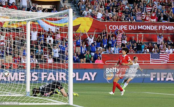 Goalkeeper Wang Fei and Li Dongna of China look on as Kelley O'Hara of the United States celebrates the goal of Carli Lloyd in the second half in the...