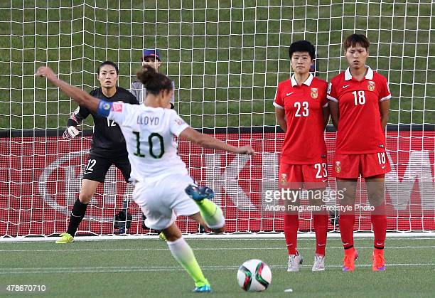 Goalkeeper Wang Fei of China looks on as Carli Lloyd of the United States takes a free kick in the first half as Ren Guixin and Han Peng of China...