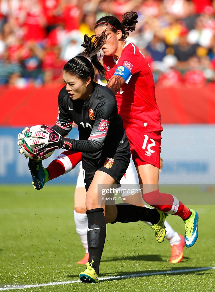 Goalkeeper Wang Fei of China PR makes a save on a shot against Christine Sinclair of Canada during the FIFA Women's World Cup Canada 2015 Group A...