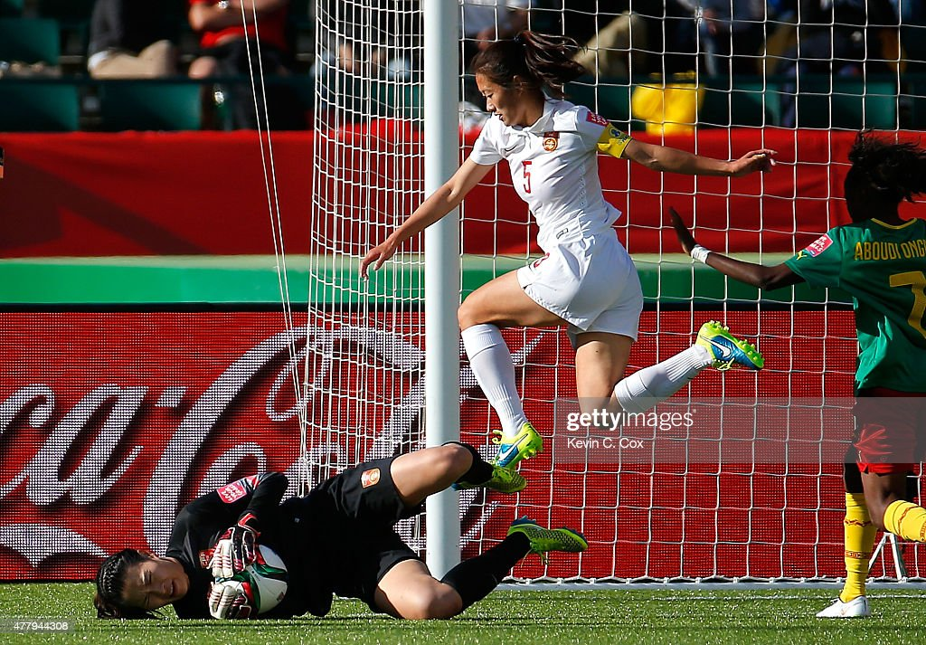 Goalkeeper Wang Fei of China PR saves a shot on goal against Cameroon during the FIFA Women's World Canada 2015 Round of 16 match between China PR...