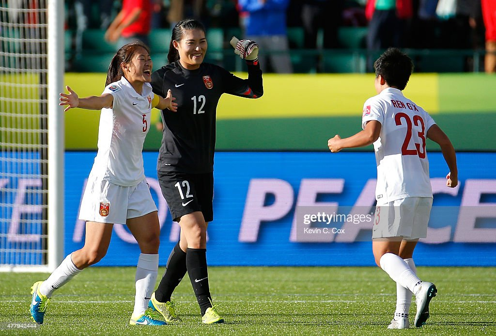 Goalkeeper Wang Fei Wu Haiyan and Ren Guixin of China PR celebrate their 10 win over Cameroon in the FIFA Women's World Canada 2015 Round of 16 match...