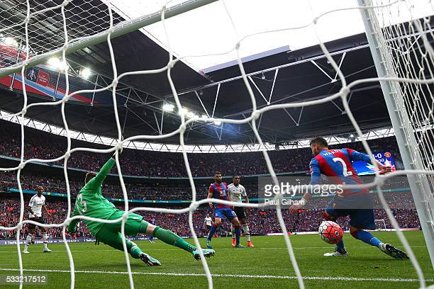 Goalkeeper Wayne Hennessey and Joel Ward of Crystal Palace fail to stop Juan Mata of Manchester United as he scores their first goal during The...