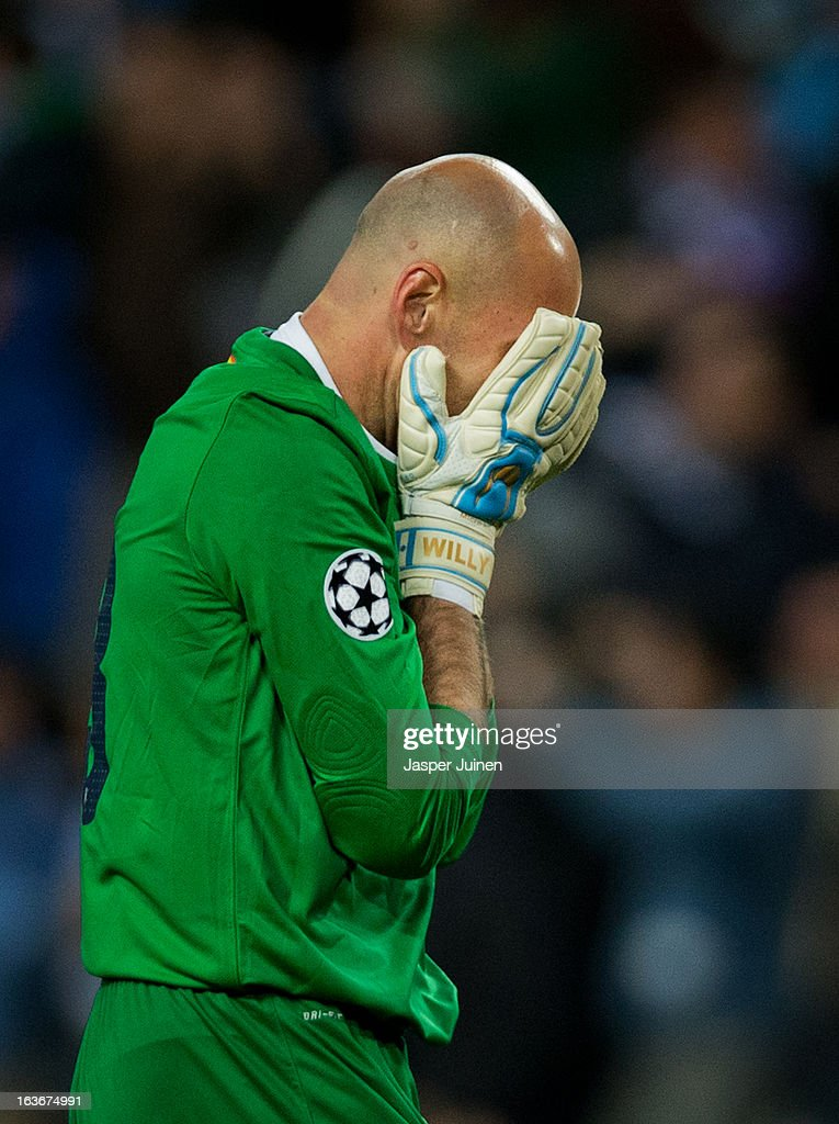 Goalkeeper <a gi-track='captionPersonalityLinkClicked' href=/galleries/search?phrase=Willy+Caballero&family=editorial&specificpeople=7800140 ng-click='$event.stopPropagation()'>Willy Caballero</a> of Malaga CF reacts after his side scored their second goal during the UEFA Champions League Round of 16 second leg match between Malaga CF and FC Porto at La Rosaleda Stadium on March 13, 2013 in Malaga, Spain.