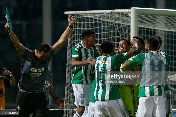 Goalkeeper Wilson of Brazil's Coritiba celebrates with team mates after stoping a shot on goal during their Copa Sudamericana football match against...