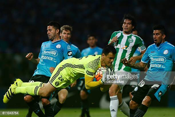 Goalkeeper Wilson of Brazil's Coritiba stops a shot on goal during their Copa Sudamericana football match against Argentina's Belgrano at the Mario...