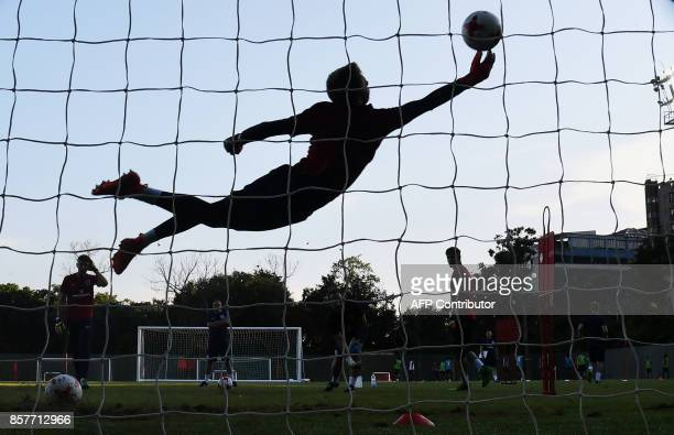 A goalkeeper with the U17 English football team practices at the Sports Authority of India complex ahead of the forthcoming FIFA U17 World Cup in...