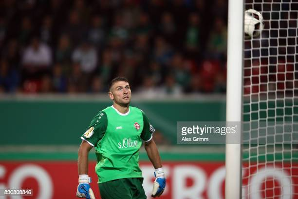Goalkeeper Wolfgang Hesl of Wuerzburg lets in a goal from Milos Veljkovic of Bremen during the DFB Cup first round match between Wuerzburger Kickers...