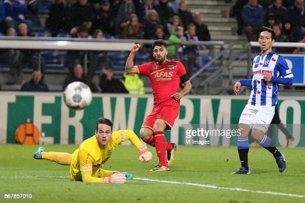 goalkeeper Wouter van der Steen of sc Heerenveen Alireza Jahanbakhsh of AZ Yuki Kobayashi of sc Heerenveen during the Dutch Eredivisie match between...