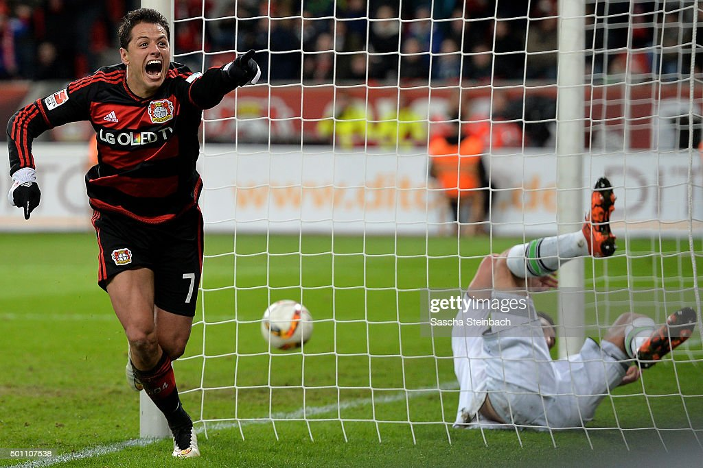 Goalkeeper Yann Sommer (R) of Moenchengladbach is beaten by Chicharito (L) of Leverkusen scoring his team's fifth goal during the Bundesliga match between Bayer Leverkusen and Borussia Moenchengladbach at BayArena on December 12, 2015 in Leverkusen, Germany.
