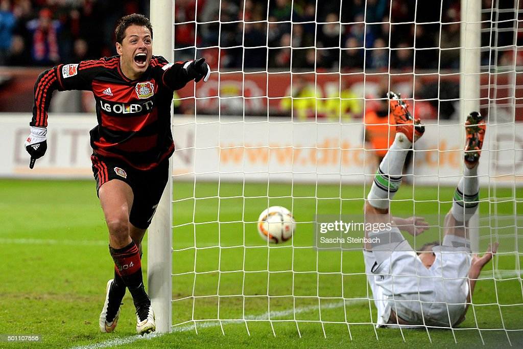 Goalkeeper <a gi-track='captionPersonalityLinkClicked' href=/galleries/search?phrase=Yann+Sommer&family=editorial&specificpeople=5781332 ng-click='$event.stopPropagation()'>Yann Sommer</a> (R) of Moenchengladbach is beaten by Chicharito (L) of Leverkusen scoring his team's fifth goal during the Bundesliga match between Bayer Leverkusen and Borussia Moenchengladbach at BayArena on December 12, 2015 in Leverkusen, Germany.