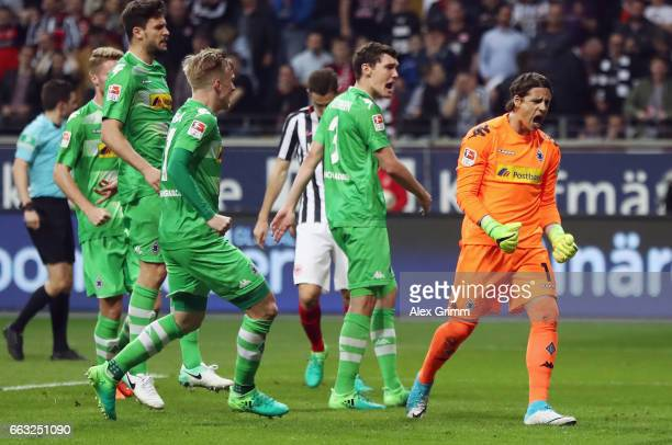 Goalkeeper Yann Sommer of Moenchengladbach reacts after saving a penalty from Marco Fabian of Frankfurt during the Bundesliga match between Eintracht...