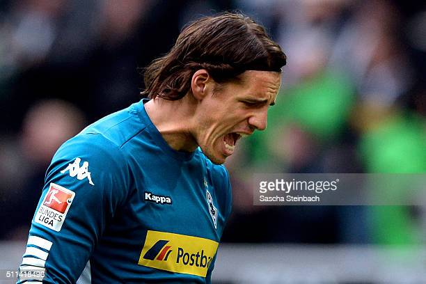 Goalkeeper Yann Sommer of Moenchengladbach reacts as Mahmoud Dahoud scores the opening goal during the Bundesliga match between Borussia...