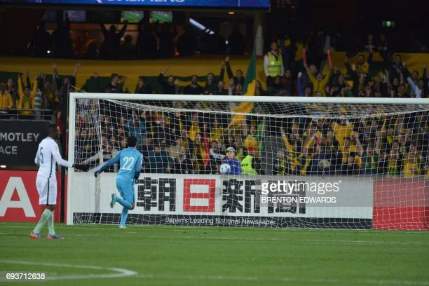 Goalkeeper Yasser Al Mosailem of Saudi Arabia watches the ball go into the net for Australias first goal during the World Cup football Asian...