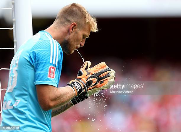 Goalkeeper Yoel Rodriguez of Valencia spits water on his gloves